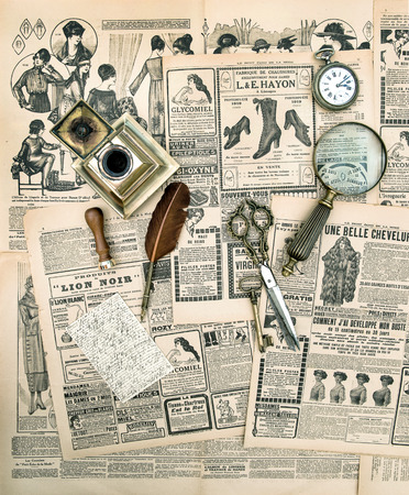 antique accessories and writing tools, vintage fashion magazine for the woman  aged paper background photo