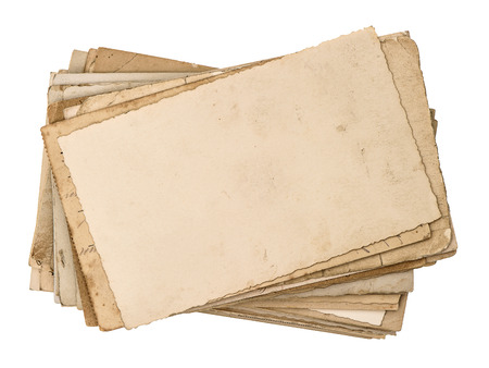 old postcards isolated on white aged paper texture photo