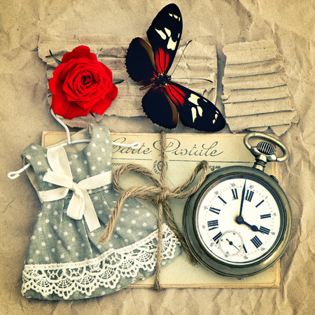 old love mails, vintage pocket watch, red rose flower and butterfly  nostalgic romantic retro style toned picture photo