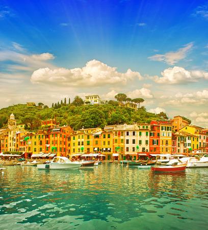 south italy: Beautiful sunset in Portofino village on Ligurian coast, Italy  mediterranean sea landscape  Vibrant colors with sun shine effect