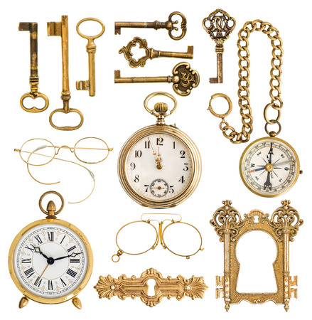 collection of golden antique accessories  vintage keys, clock, compass, glasses, pocket watch, frame isolated on white