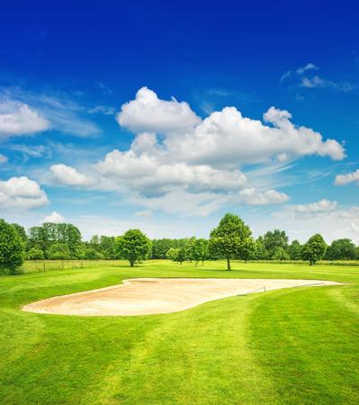 golf course and beautiful blue sky  european green field landscape photo