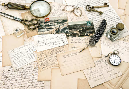 old handwritten french letters and postcards, vintage office accessories  nostalgic paper  photo