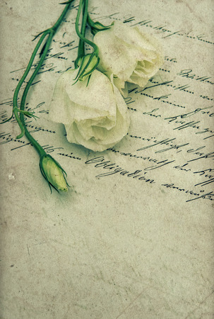 old handwritten love letter with flowers. nostalgic sentimental background. retro style toned picture Stock Photo