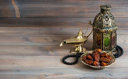 arabian food: Dates, arabian lantern and rosary. Islamic holidays concept. Ramadan decoration Stock Photo
