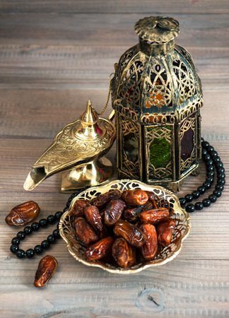 Still life with dates, arabic lantern and rosary. Oriental decoration