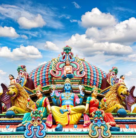 Oldest Hindu temple Sri Mariamman in Singapore over beautiful blue sky photo