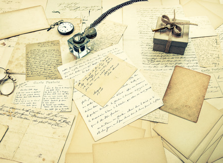 old letters: old letters, vintage postcards and antique feather pen. nostalgic sentimental background. retro style toned picture Stock Photo