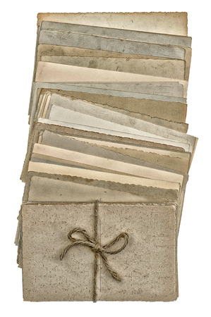 postcards isolated on white background. pile of old blank paper cards. vintage style toned picture photo