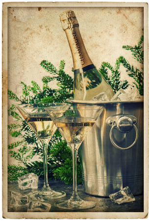 bottle of champagne with two glasses  festive decoration  grunge picture in retro postcard style photo