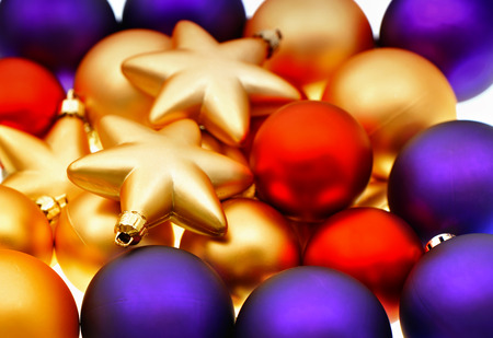 lila: christmas balls decoration  closeup of lila, red and golden baubles  selective focus  vibrant colors