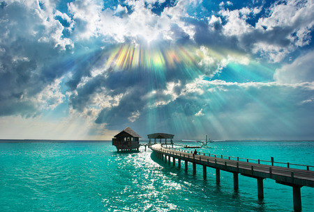 beautiful sunset on the sea  holiday background with dramatic sky and sunbeams photo