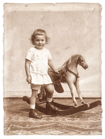 old photo of little girl with rocking horse toy nostalgic picture photo
