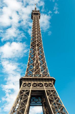 la tour eiffel: The Eiffel Tower  La Tour Eiffel  in Paris over cloudy blue sky