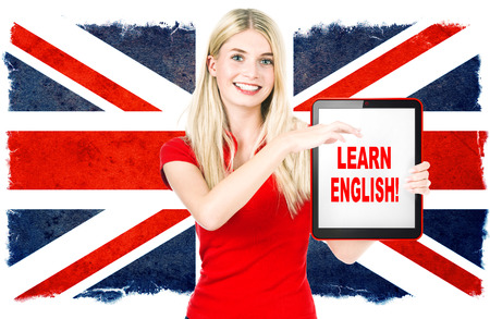 computer language: young woman holding tablet pc on the background with british national flag  english learning concept