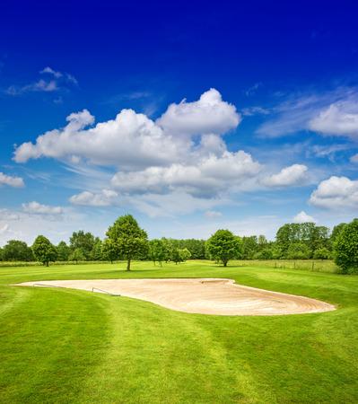 green golf course and dramatic blue sky  european field landscape Banco de Imagens