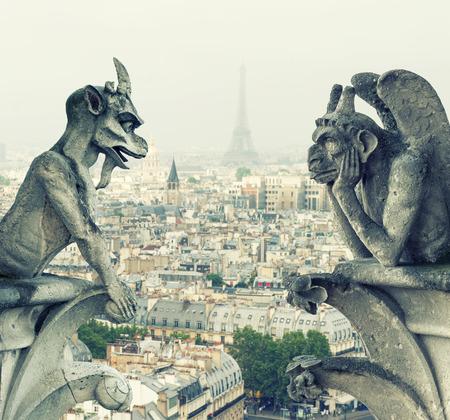 Stone demons gargoyle and chimera from Notre Dame de Paris  Vintage style picture