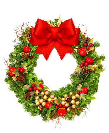 christmas wreath with red ribbon and golden decoration isolated on white background photo