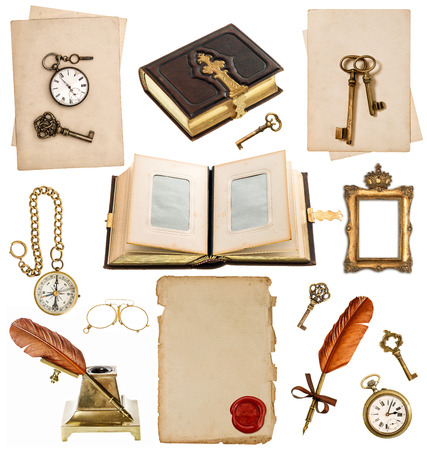 old paper sheets with vintage accessories isolated on white background  antique clock, key, postcard, photo album, feather pen, inkwell, glasses, compass photo