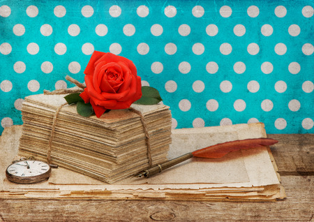 old love letters and postcards with pink rose flower isolated on white background  Nostalgic sentimental still life  Retro style designed picture photo