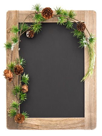 christmas memories: chalkboard with wooden frame and christmas decoration isolated on white background  vintage blackboard with place for your text