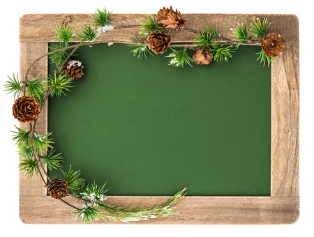 blackboard with wooden frame and christmas decoration isolated on white background  antique chalkboard with place for your text photo