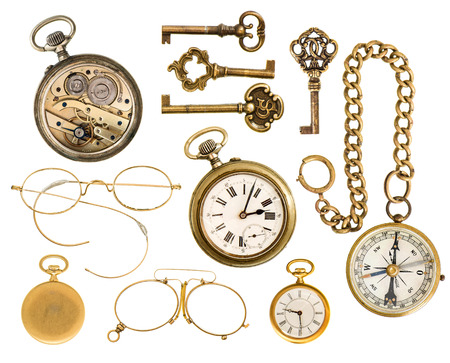 collectible: set of golden vintage collectible accessories  antique keys, clock, compass, glasses isolated on white background Stock Photo
