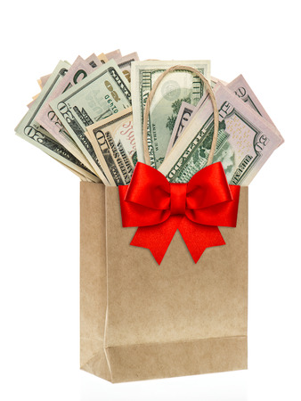 paper bag with american dollars and red ribon bow decoration. christmas shopping concept photo