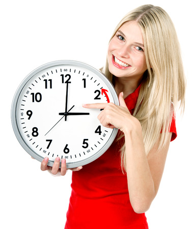 young woman holding a clock. time management. winter time concept (Daylight Saving Time) Banco de Imagens