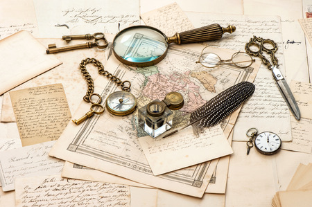 antique accessories, old letters and maps, vintage ink pen. nostalgic sentimental journey background. ephemera photo