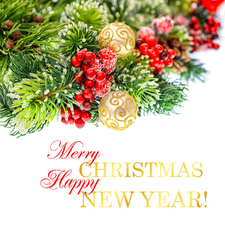nappy new year: christmas tree branch with red berries and golden balls isolated on white background. festive decoration with sample text