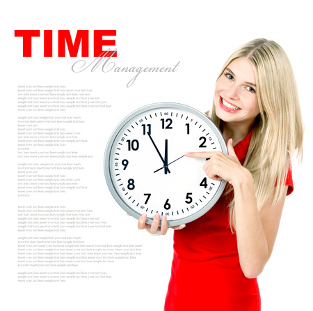 time management concept. five to twelve. young beautiful woman with big clock on white background with sample text photo