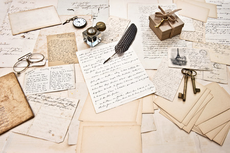 antique accessories, old letters, open diary book and vintage ink pen. nostalgic sentimental scrapbook paper background photo