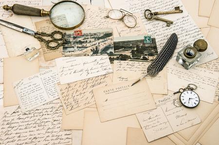 antique accessories, old letters and postcards, vintage ink pen. nostalgic sentimental background. ephemera photo