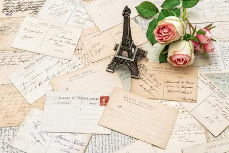 roses, antique french postcards carte postale and souvenir Eiffel Tower from Paris. nostalgic sentimental holidays background photo
