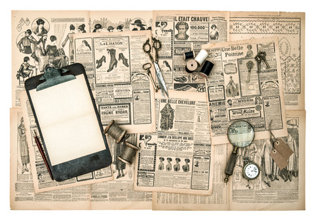 antique accessories, sewing and writing tools, vintage fashion magazine for the woman. retro style toned picture photo