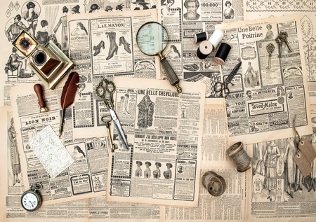 antique accessories, sewing and writing tools, vintage fashion magazine for the woman with advertising. retro style toned picture photo