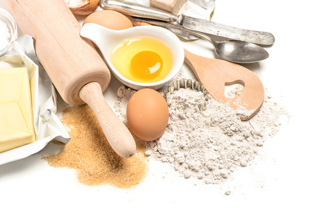 baking ingredients eggs, flour, sugar, butter, yeast. dough preparation. food background photo