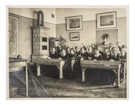retro picture of classmates. group of children in the classroom. antique photo with original film grain, blur and scratches