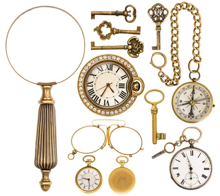 single object: collection of golden vintage accessories, jewelry and objects. antique keys, clock, loupe, compass, glasses isolated on white background