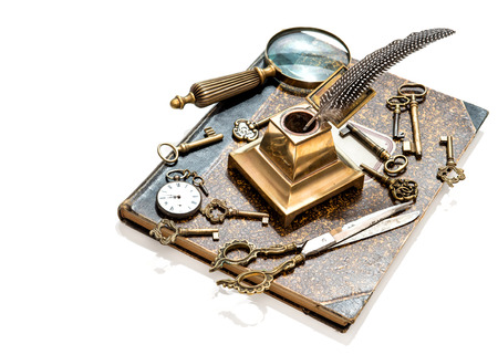 collectibles: antique keys, pocket watch, ink pen, loupe, book isolated on white background. collectibles and vintage