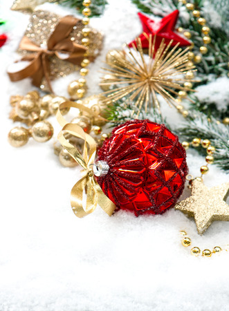 christmas composition with red baubles and golden decoration on white background photo