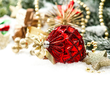 christmas composition with red baubles and golden decoration on white background
