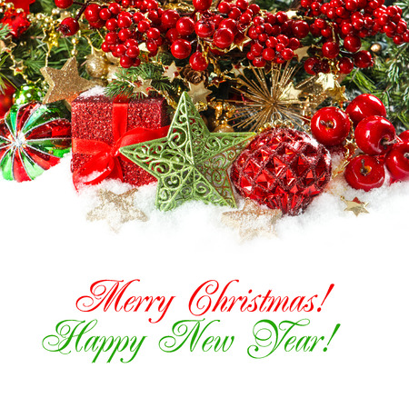 festive christmas decorations in red and gold. holidays background with sample text Merry Christmas! Happy New Year! photo