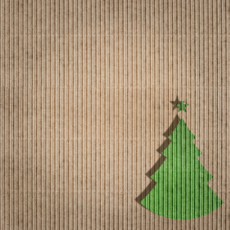 recycling paper with green christmas tree. environment friendly card concept. paper texture. photo