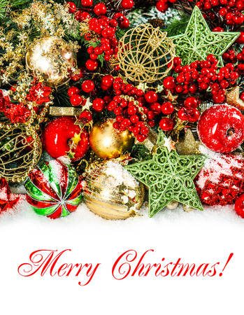 colorful christmas decorations in red gold green festive background with sample text merry