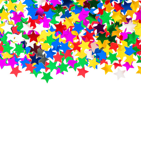 star shaped red, blue, green, gold confetti on white background. festive colorful background photo