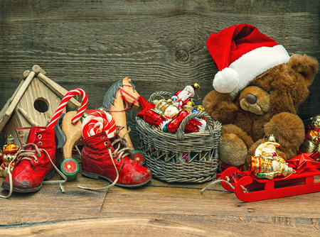 nostalgic christmas decoration with antique toys over wooden background. retro style picture Stock Photo