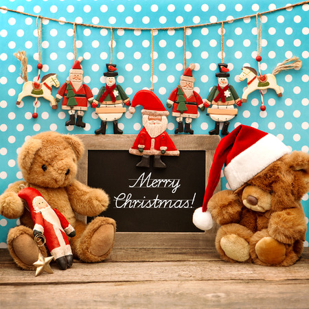 vintage christmas decoration with antique toys. retro style home interior blackboard with sample text Merry Christmas photo
