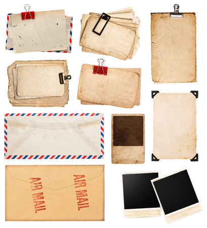 pile of old postcards isolated on white background. vintage paper sheets with clip. old photo frames. air mail envelope. retro design photo